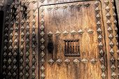 Sun Shining On The Wooden Door Of Rectorship Of The University Of Granada