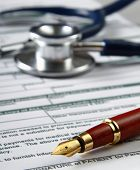 picture of statements  - Stethoscope on medical billing statement on table - JPG