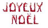 Elfs Forming The Phrase 'joyeux Noel'