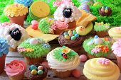 stock photo of sheep  - Easter cupcakes and Easter eggs display - JPG