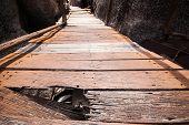 Wooden Bridge With Rock