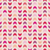 Aztec Chevron seamless vector colorful pattern, texture or background with pink zigzag stripes.