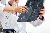 stock photo of infirmary  - Young doctors consulting difficult medical case in office - JPG