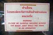 Warning Information Plate At Thailand Railway Station