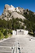stock photo of mount rushmore national memorial  - Mount Rushmore National Memorial with the visitors center amphitheater in the foreground - JPG