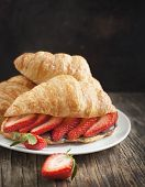 Fresh Croissants With Strawberry And Chocolate Nuts Cream