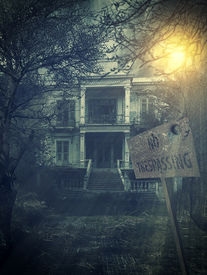 foto of scary haunted  - old abandoned  Scary Haunted house with no trespassing sign - JPG