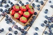 Fresh Strawberries And Blueberries In Heart Shape Basket On Kitchen Table