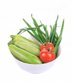 Bowl with marrows and tomatoes.