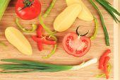 Composition of fresh sliced vegetables.