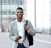 Young Man Text Messaging On Mobile Phone