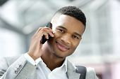Handsome Young Man Smiling With Cellphone