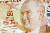 stock photo of turkish lira  - A used Turkish banknote for 50 Lira with the focus on the portrait of late President Mustafa Kemal Ataturk.
