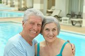 Senior couple by pool