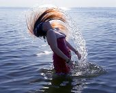 Young woman doing a hair of water splash in sea