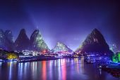 Yangshuo, China cityscape and karst mountains on the Li River.