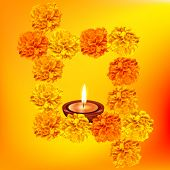 Vector background of decorative diya with flowers
