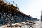 image of skyway bridge  - Scaffolds at road construction site at sunny day - JPG