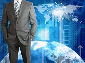 Businessman with Earth, skyscrapers and world map