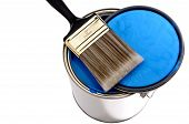 Paint Brush And Lid On top Of A Can Of Blue  Paint