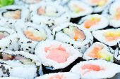 Sushi rolls on a plate from above. Shallow DOF