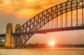 Sun sets over Harbor Bridge in Sydney, Australia