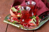 pomegranate fruit tea in traditional glass cups