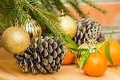 Cones, Tangerines And Christmas Balls On Spruce Branch