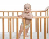 Infant Child Baby Boy Toddler  In Wooden Bed Looking Up