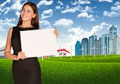 Businesswoman with landscape and city