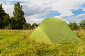 Pitched Tent In Meadow On Sunny Day