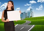 Businesswoman with road leading to business center