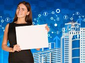 Businesswoman with skyscrapers and network