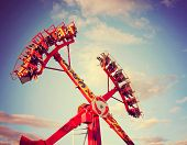 a fair ride during dusk toned with a retro vintage instagram filter  effect