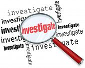 Magnfiying glass on the word investigate to illustrate detective or police work researching facts in