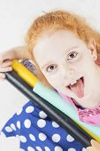 Funny Red-haired Caucasian Girl Making Faces
