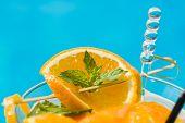 Fresh Orange Mojito by the swimming pool