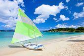 Catamaran at beautiful tropical Caribbean beach