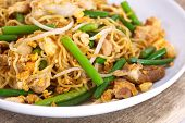 Chinese stired fried noodles with leek vegetable and pork