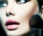 Makeup. Make-up Face. Big Make up brush. Makeup applying concept. Beautiful fashion model girl face