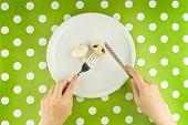 Woman Eating Edible Mushroom, Top View