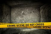 picture of crime scene  - Crime Scene Do Not Cross Yellow Headband Tape in dark concrete interior - JPG