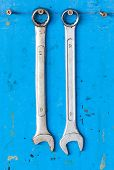 2 Dirty Metallic Screw Wrench Hanging With The Grunge Blue Background
