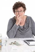 picture of retirement age  - Sad pensioner woman have money problems  - JPG