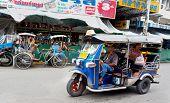 Tuk Tuk Or Sam-lor Run Through The Streets