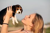 woman owner with pet beagle dog