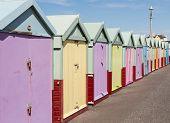 Colourful Beach Huts In Bright Sunshine