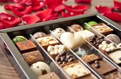 Box Of Tasty Chocolates Among Rose Petals - A Romantic Valentine Gift