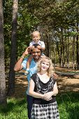 African American Happy Family: Black Father, Mom And Baby Boy On Nature. Use It For A Child, Parenti