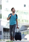 Cool Guy Smiling With Suitcase And Bag